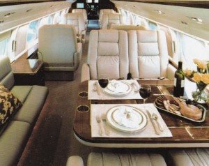 Luxury jet charter interior image with food and wine