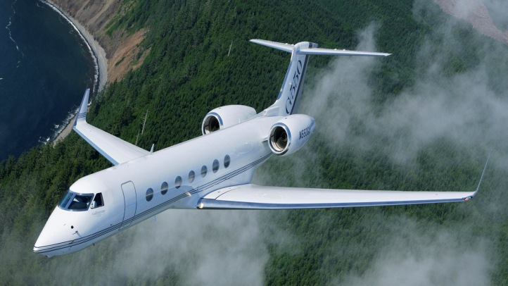 Gulfstream G550 Charter Flying Over Trees